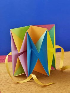 This is a project in my book, Origami Card Craft. I love the bright colored origami paper.