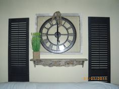 2 old shutters (actually plastic!), old window, cool big clock tied with burlap, and a repurposed shelf that I distressed. Plastic Shutters, Diy Shutters, Big Clocks, Backyard Makeover, Window Frames, Hgtv, Repurposed, Family Room, Clock Work
