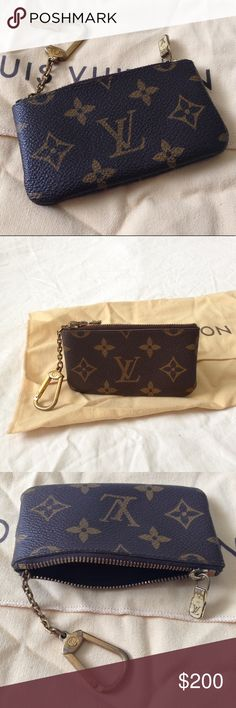 LOUIS VUITTON Monogram Canvas Key Pouch, Size: OS LOUIS VUITTON Monogram Canvas Key Pouch, Size: OS. This practical pouch holds change and keys and slips easily into a bag or pocket. Monogram canvas, cross grain leather lining, zipper closure, key-ring, hooks onto the D-rings found in most Louis Vuitton bags. Authenticity code: ET1921. Pouch in excellent used condition. Key chain and zipper closure have tarnish (fair used condition). Louis Vuitton Accessories Key & Card Holders
