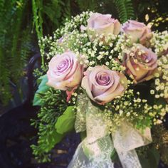 Lavender Roses, Babies Breath and Seeded Euchalyptus with Lace in A Purple mason jar