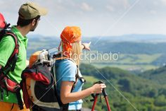 Hiking young couple point at panoramic view Royalty Free Stock Photo