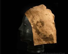 A twisted and crumpled object found in a late 10th-century pit turned out to be an almost complete silk headdress. A hood-shaped cap, it had...