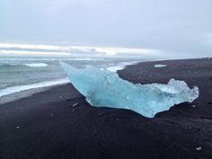 The black iceberg beach in Iceland. Jökulsárlón glacier lagoon is on the south coast of Iceland. The glacier breaks up and then floats into the sea where they get washed up on the volcanic black beach. Absolutely epic and amazing. My favourite snap from my holiday in April 2014.