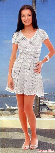* Openwork dress with a high waist and flared skirt.