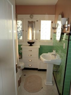 Retro Mint Green Bathroom , One of the reasons we bought our house 6 years ago. This bathroom was just amazing and yes the tile is original. :-). We added paint, new light fixtures and the L shaped shower curtain rod. , Bathrooms Design