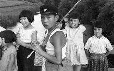 夏休み2. Japanese boy with fishing pole. Smiling girls. 1957.