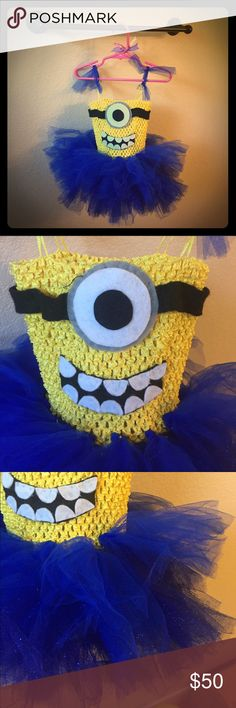 Baby girl's Minions Halloween costume!! A GREAT find!! This custom made Minion costume is perfect for your little girl who is a huge Minions fan!! My baby girl wanted to be a minion and I couldn't find this in stores, so I made it. Worn w/ white onesie underneath, but it would go great with a yellow one too! There is glitter tulle in the tutu for a little pizazz! We got sooo many compliments!! She was 22 months when she wore this so I guesstimate this would fit 18-24 months. It took a few…