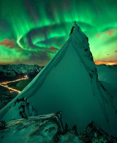 The Aurora Borealis on a Mountaintop near Lofoten Norway [by Max Rive][2916  3579]