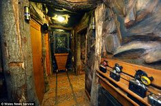 Take the plunge: The corridor of The Little Crown Inn has been turned into a mine shaft. Welsh guest house turned into coal mine at a cost of £200,000... complete with mining lamps for lighting and 1984 strike memorabilia on the walls