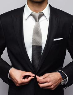 Black peak lapel with knitted tie