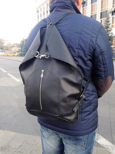 Black natural leather city backpack. You can use it also as tote bag. Example img1.etsystatic.com/102/0/13156668/il_570xN.1110384403_nw3p.jpg  This backpack is suitable for men and for women.   Product description: Height: 45 cm / 18 Width: top 41 cm / 16, button 31 cm / 12 Depth : 14 Cm / 5,5 Max. straps length: 2 x 85 cm / 33 Weight: 0.7 kg Size: fits A4 paper and laptop   - Italian natural leather keeps shape of the bag. - Metal hoock - Adjustab...