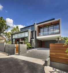 contemporary house exterior design ideas wood concrete garden fence garage