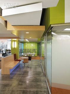 Safe and Sound: APX Alarm's Hip Utah Headquarters Office. Canopies, one painted and the other veneered in oak, interlock in a corridor. #office