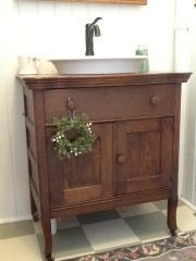 Antique dresser with copper bucket vessel sink ok where can i find this sink i want it for Where can i buy bathroom cabinets