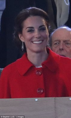 The Duchess of Cambridge wore a white dress and kept warm from the chilly night by layerin...
