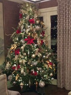 Silver and gold with pop of red Christmas tree
