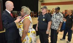 Florida Gov. Rick Scott hangs a Governor's Veterans Service Award medal around the neck of U.S. Army veteran Maria Maddox during a ceremony held at the Robert F. Ensslin Jr. Armory in St. Augustine on Thursday, June 25, 2015. Gov. Scott presented the award to hundreds of active duty, retired or honorably discharged military members during the event. Maddox traveled from her home in Seville for the ceremony.  Peter.Willott@staugustine.com