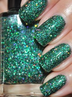 On A Budget is loaded with 5 different green glitters and gold holographic glitter in a subtle light green shimmering base. $9.25 via Etsy // Green polish is the other trend I'm really into right now :D