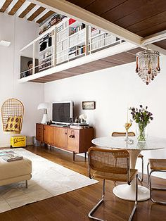 sideboard, round table, white walls, yellow accents