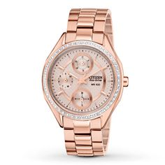 This women's watch from Citizen showcases shimmering crystals along the bezel, encircling a pink dial. The rose-tone stainless steel case pairs perfectly with a matching bracelet and houses rose-tone luminous hands and chronograph dials. The watch features a date function, second hand and water-resistance up to 100 meters. Citizen Eco-Drive is fueled by light, any light, so it never needs a battery.