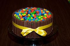 Could do square tin and a green/white/brown m&m mix for a simple minecraft cake?
