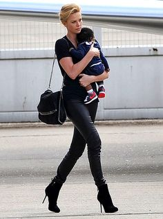 Charlize Theron. I know she adopted her son, but I still feel she is fierce for being a mama that wears leather pants