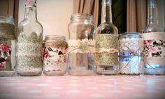 Decorated mason jars and bottles for wedding table decorations