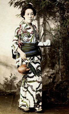 "Geisha Aihachi of Nagasaki, 1890s, Nagasaki, Japan.  ""In this photograph, Aihachi is wearing a superb Yukata (Cotton Kimono) with a Hagoromo (Celestial Feather Robe) motif. The Maruyama district has long been known for its fabulous kimonos. A famous saying in Old Japan was: ""I wish I could have a beautiful courtesan of Shimabara [Kyoto] with the dashing spirit of a Yoshiwara [Edo] woman, wearing the gorgeous apparel of Maruyama [Nagasaki], at a sumptuous ageya of Shinmachi [Osaka]"