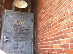 TRIC is also a public location (the outside of the building), so just like the Rivercourt, many fans come and sign their names, write quotes, and write messages to the cast. The only difference is that here at TRIC, since the outside of the building is not used for filming very often, the One Tree Hill crew left all the writing on the bricks.