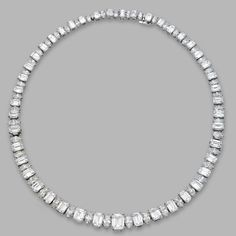 PLATINUM AND DIAMOND NECKLACE/BRACELET COMBINATION, HARRY WINSTON. The graduated necklace set in the center with an emerald-cut diamond weighing approximately 2.25 carats, further set with smaller emerald-cut diamonds weighing 25.56 carats, alternating with marquise-shaped diamonds weighing 13.56 carats, length 14 3/8  inches, converts into two bracelets, lengths 7 and 6¼ inches, necklace can be shortened by removing 1 inch segment, unsigned.