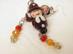 Unique Handcrafted Thanksgiving Pilgrim Artisan Lampwork Glass Earrings with Gorgeous Shimmery Swarovski Crystals in Autumn Hues, and Sterling Silver French Style Ear Wires. Handcrafted by MelancholyMind, $19.95