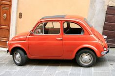 fiat 500 - cutest little car ever!! love the new ones too.