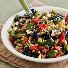 This great summer salad has whole wheat orzo, roasted vegetables, Feta, Olives, and Herbs.