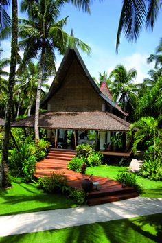 Dedon Island - A guest villa surrounded by palm trees