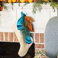 The Stockings | Supplement your traditional holiday decor with new finds from your own backyard. Here, simple spruce clippings and magnolia leaves tied with a blue ribbon give old family stockings a fresh new look.