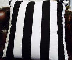 Striped cushion .  Black and white cushion .