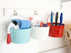 Cute idea to hang buckets from hooks for storage of all sorts - kitchen, playroom, office, laundry room, patio, garage. (Link just takes you to lowes website, but nothing related to this picture)
