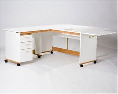 """The Quilters Workstation's L-shape design offers plenty of both leg and project space. Closed: 61½"""" W x 60"""" D Open: 77"""" W x 76"""" D"""