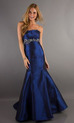 Navy blue strapless ball gown (and the model looks SUPER happy about it too!)