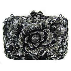 The classy flower new hard clutch is perfect for that special occasion or for a night on the town.  Featuring Swarovski crystal, they come with a shoulder chain and the famous Butler & Wilson edge.