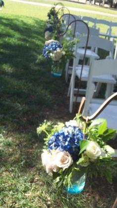 Aisle:#masonjars and #shephardhooks #florafetish #weddingaisle