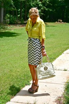 Summer outfit: yellow shirt and chevron-striped skirt paired with chunky heels.