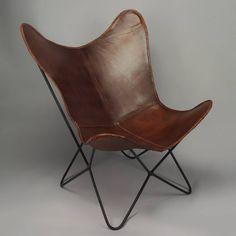 Trendy zetel in bruin lederen butterfly zit en smeedijzeren onderstel
