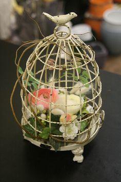 sweet floral arrangement inside a shabby chic birdcage <> (bird decor, motif)