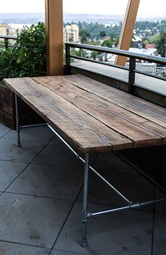 great reclaimed wood table - seems pretty simple, reclaimed wood boards, and galvanize piping base - might look better with black piping. M So far I want my table top to look like this or close to looking like this table Pipe Table, Wood Table, Pipe Desk, Patio Table, Picnic Table, Pipe Furniture, Industrial Furniture, Reclaimed Wood Projects, Outdoor Dining