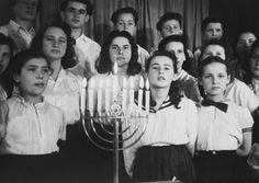 Holocaust survivors celebrating Chanukah at the Landsberg Displaced Persons Camp 1945