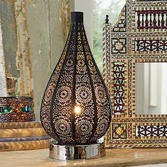 £65.00 Casablanca Lamp Pierced metal lamp with black finish and nickel-plated base reflecting Moorish motifs.