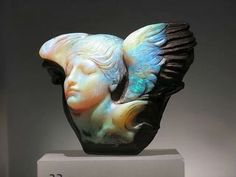 Boulder Opal Carving  -- saw this IRL. it's as big as my head.