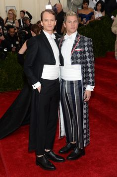 These two look like stylish clowns ready to perform at the circus. Awful length pants and cumberbunds (sp?) which draw attention to their stomach and in fact make them look alot bigger than they are. Just hideous.
