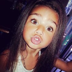 Beautiful little girl with huge chocolate brown eyes